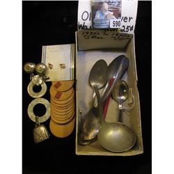 "Menagerie of Silverware; Cardboard Circles; hose section; Gerber Baby Spoon; ""Peggy Ann Birth Record"