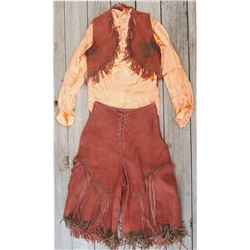 nice 1930-40's cowgirl outside, suede vest & split riding skirt