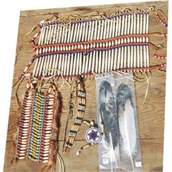 Indian decorator pieces, two breast plates, feathers and beaded choker