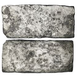 "Small ""tumbaga"" silver bar (""half-brick"" shape) #M-43, 2171 grams, stamped with assayer B~Vo, serial"