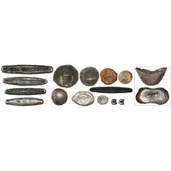 Collection of fifteen pieces of silver primitive money from southeast Asia (1200s to 1800s).