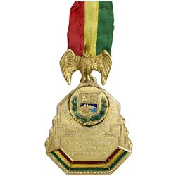 Oruro, Bolivia, engraved and enameled gold service medal with ribbon and eagle connector, 1938.