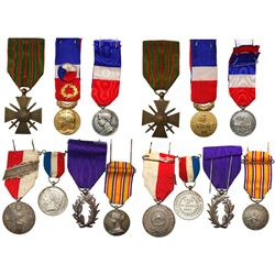 Lot of seven base-metal French medals (breast badges) with ribbons, 1901-1977.