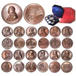 Set of thirteen bronze medals for Pope Pius IX, dated 1847-1864, in original case.