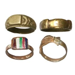 Lot of four brass / copper rings, including one made from a coin from Peru, 1800s.