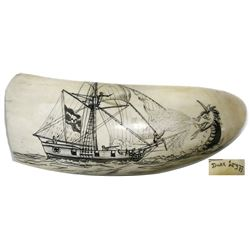Whale-tooth scrimshaw of a pirate ship by Duke Long (1987), signed and dated.