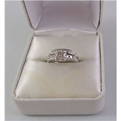 14KT WHITE GOLD LADIES RING (WED SET SOLDERED TOGETHER) SET WITH 1 DIAMOND AND 16 OTHER DIAMONDS.