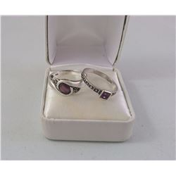 2X SILVER LADIES RING SET WITH MAUVE STONE 1 WITH 4 MARCASITES (2 MISSING) 1 OVAL AND ONE OTHER