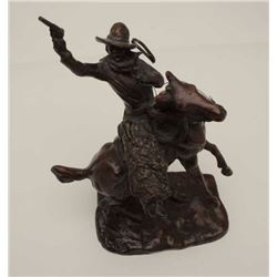 "Older copy of a C.M. Russell, approximately  13"" in height, great patina; cowboy on  rearing horse."