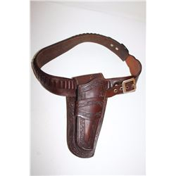 Tooled leather single loop holster and  cartridge belt for a Colt SAA revolver or  similar size hand