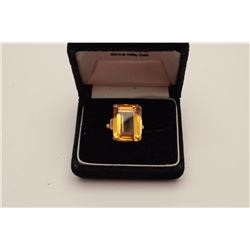 One 14k rose gold ring set with a beautiful  emerald cut orange citrine weighing approx  15ct  Est:$