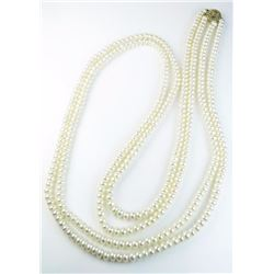 Elegant double stranded Button freshwater  pearls of over 30 inches in length with high  luster and