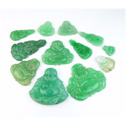 Very large lot of carved Green Jade weighing  over 480 carats. Estimates $800-$1,200