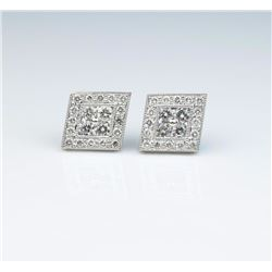 Stunning ladies earrings fine set with 40  round diamonds weighing approx. 1.00 carats  of F-G color