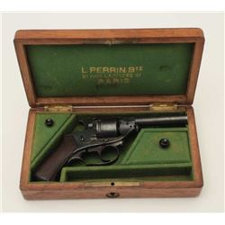 Perrin patent double action pocket size  rimfire revolver in original period casing.  The pistol is