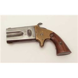 "American Arms O/U swivel derringer, .41RF  caliber, 2.5"" barrels, brass frame, wood  grips, S/N 1156"