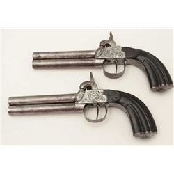 "Pair of Belgian O/U percussion pistols, .38  caliber, 4.5"" barrels, engraved frames and  trigger gua"