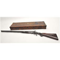 Desirable Holland & Holland double under  lever hammer rifle in leather covered wood  casing with ac