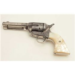 "Engraved Colt SAA revolver, .45 caliber,  4.75"" barrel, nickel finish, raised carved  eagle pearl gr"