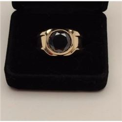 One men's ring in 14k yellow gold set with a  5.7ct round brilliant cut black diamond  Est:$3,000-3,