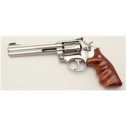 "Smith & Wesson Model 617 DA revolver, .22LR  caliber, 6"" barrel, stainless, finger groove  wood meda"