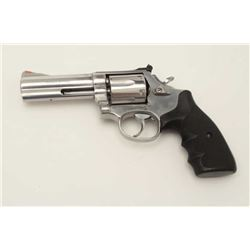 "Smith & Wesson Model 686 DA revolver, .357  Magnum caliber, 4"" barrel, stainless,  checkered finger"
