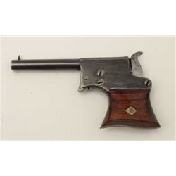 "Remington Saw Handle derringer, .22RF  caliber, 3.25"" barrel, blued finish, wood  grips, no visible"
