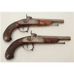 "Pair of percussion French pistols, each  approximately 13"" overall with 7"" barrels,  checkered wood"