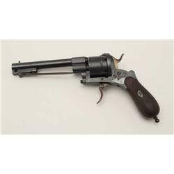 "Double Action revolver of large size with  under mounted folding bayonet. Measures 11""  overall with"