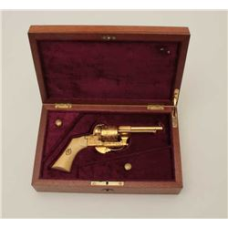 Engraved pinfire revolver, gold finish, ivory  grips, S/N 62033, wood presentation casing;  gun is i