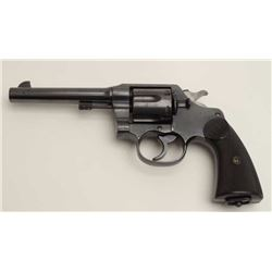 "Colt New Service DA revolver, .45 Colt  caliber, 5.5"" barrel, blued finish, checkered  black hard ru"