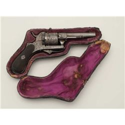 Pipe cased pinfire revolver circa 1860s  showing floral engraving and checkered wood  grips. Measure