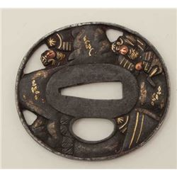 A good iron tsuba beautifully chiseled and  pierced with elaborate scene of two samurai  in mountain