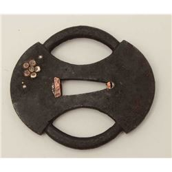 Two genuine old iron tsuba. One pierced and  inlaid with silvered copper peonies. The  other with ch