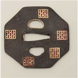 An unusual octagonal iron tsuba pierced with  screens in copper and gold. 200-400 years  old. EST:$2