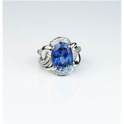 Contemporary design ladies ring set with a  created blue Sapphire weighing approx. 7.00  carats high