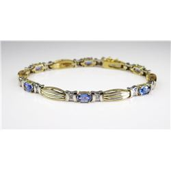 Fine quality ladies bracelet set with six  oval Tanzanites weighing approx. 3.50-4.00  carats accent