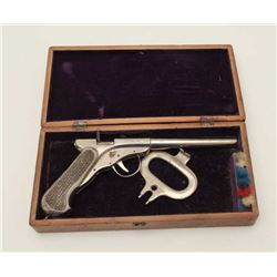 Spring action dart pistol in original case  with combination tool and cocking device.  Marked Brevet