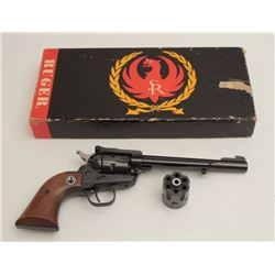 "Ruger Model Single Six revolver, .22 caliber,  6.5"" barrel, blued finish, smooth wood black  medalli"