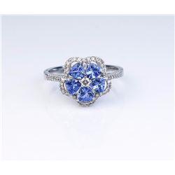 Nice Tanzanite and diamond flower design ring  set with 5 Tanzanites and 42 diamonds with a  total w