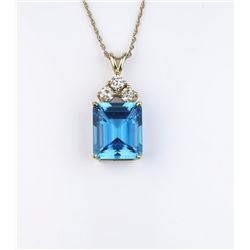 Gorgeous ladies pendant set with a fine Swiss  Blue Topaz weighing approx. 10.00 carats and  three r