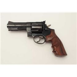 "Taurus DA revolver, .357 Magnum caliber, 4""  ported barrel, blued finish, finger groove  checkered h"