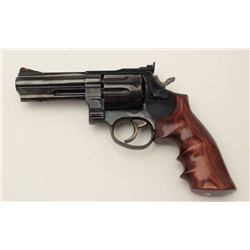 "Taurus DA revolver, .357 Magnum caliber, 4""  ported barrel, blued finish, finger groove  hardwood gr"