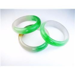 Lot of three green Jade bangles averaging  16.00 MM in diameters. Estimates $300-$400