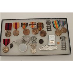 Riker case of U.S. military ribbons, medals,  dog tags and ephemera including a U.S. steel  pocket k