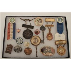 Riker case of authentic antique and  collectible pins, medals and ribbons,  originally from the famo