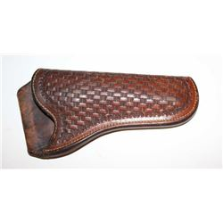 Basketweave leather holster appearing to be  for a Colt SAA revolver or similar size  handgun in goo