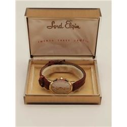 Vintage Lord Elgin Man's wristwatch in  original box; 14 Karat gold marked; 23 jewel;  near fine con