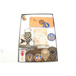 Large riker case full of effects from a WW  II/Korean War naval soldier including  patches, folding