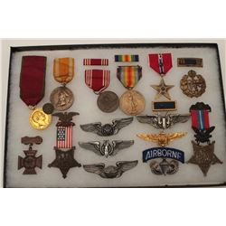 Riker case of collector military medals  including wings, Airborne, etc; also a Bronze  Star inscrib